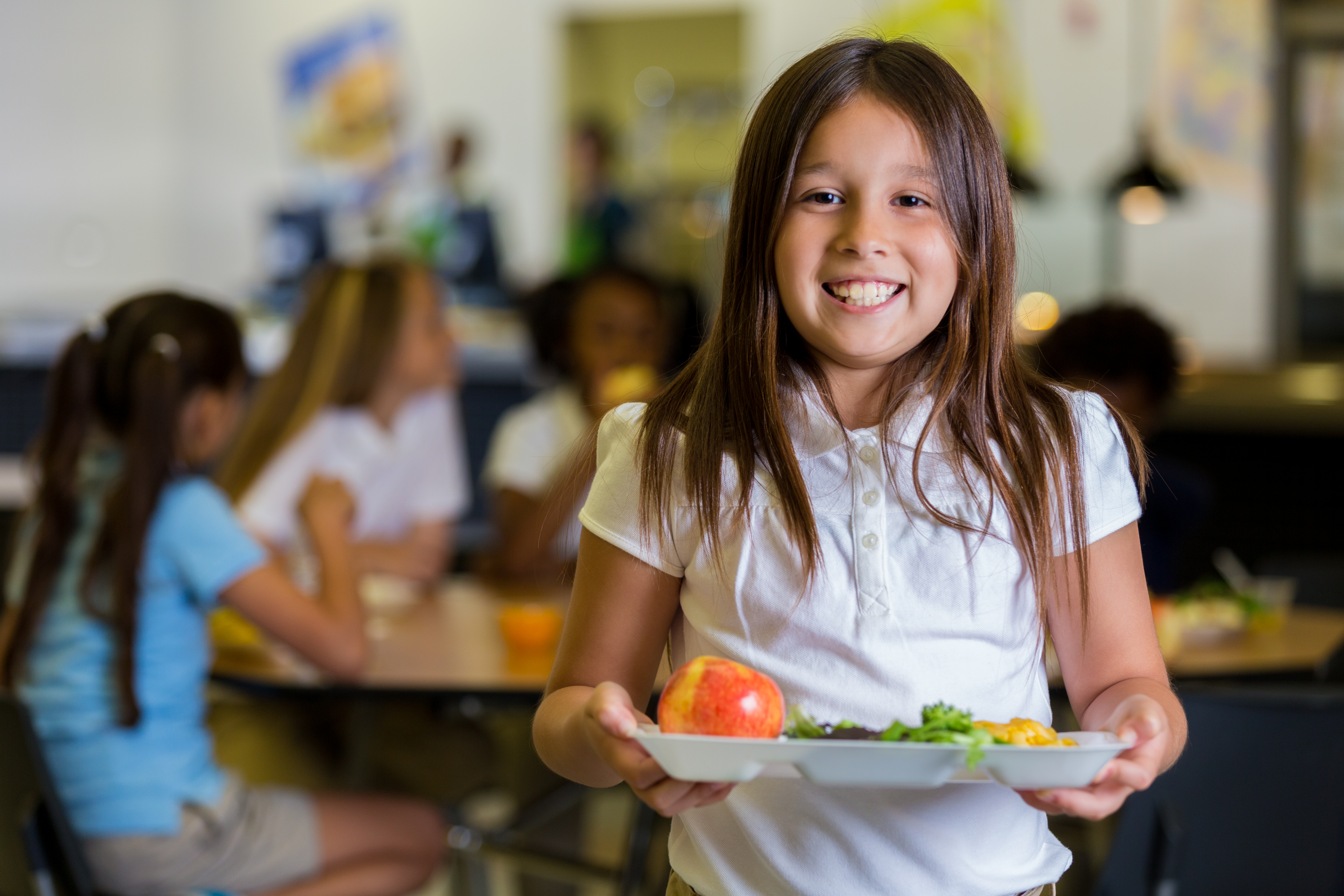 young girl with fruits & veggie lunch tray