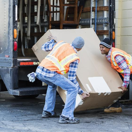 delivery men loading package