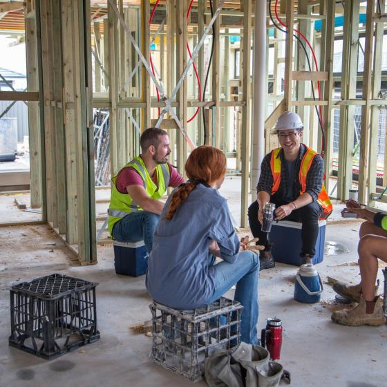 mixed gender construction workers at lunch