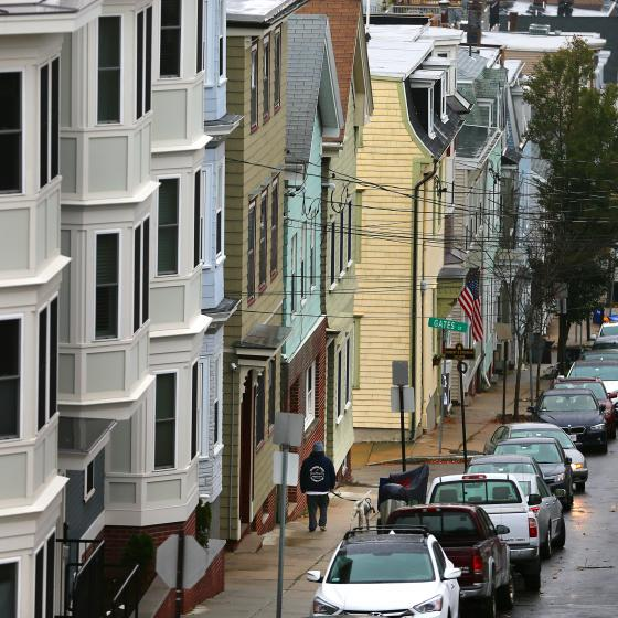 a row of crowded houses on a Boston street