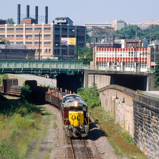 freight train going under a bridge in Youngstown, Ohio