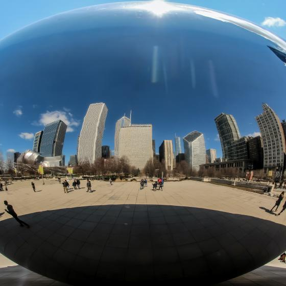 """Buildings reflected in the """"egg"""" sculpture in Chicago's Millenium park"""