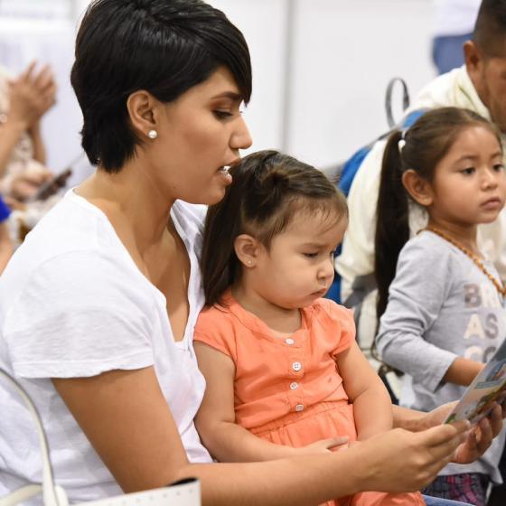 Hispanic parents reading to children